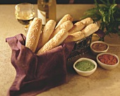 Breadsticks in a Basket with Various Dipping Sauces