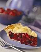 A slice of triple berry pie