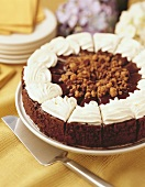 Chocolate torte with ganache and whipped cream topping