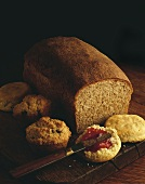 Homemade Bread Loaf, Muffins and a Biscuit with Jam