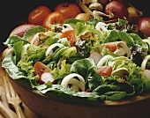 Garden salad with tomatoes, onions, mushrooms, and radishes