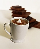 A cup of hot chocolate with whip cream and cocoa