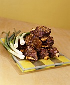 Barbecued short ribs with scallions