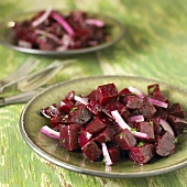 Red Beet and Red Onion Salad Served on Green Plates