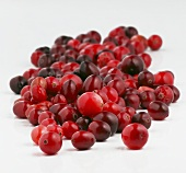 Many Fresh Cranberries on a White Background