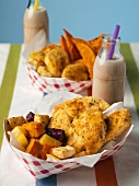 Fried Chicken Fillet Pieces with Assorted Roasted Root Vegetables in a Take Out Container