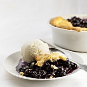 Blueberry cobbler (USA) with vanilla ice cream