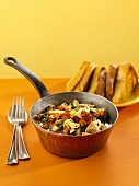 Chicken and Vegetable Stew in a Pot with Toasted Bread Triangles