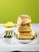 Three Scones, Stacked, with Butter and Butter Knives