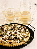 Flat Bread Topped with Feta Cheese, Green and Black Olives and Rosemary