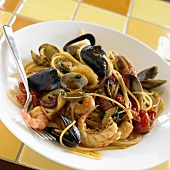 Seafood Pasta; Spaghetti With Assorted Shellfish on White Plate
