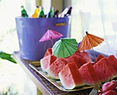 Watermelon wedges with cocktail umbrellas