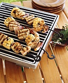 Skewered seafood and corncobs on barbecue