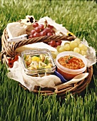 Picnic basket with chicken salad, tomato & pepper dip & grapes