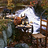 Indian Pudding Set on Outdoor Table; Mugs of Hot Chocolate on Tray; Autumn