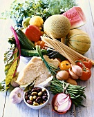 Still Life of Fresh Ingredients; Fruit, Vegetables, Pasta, Cheese and Olives