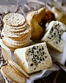 Stacks of Water Crackers with Wedges of Bleu de Haut Jura Cheese; Pears