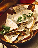 Platter of Cheese and Vegetable Quesadillas Sliced into Triangles