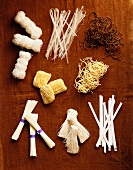 Overhead of Many Assorted Dried Noodles Used in Asian Cooking