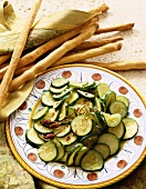 Side Dish of Sliced Sauteed Zucchini with Chili Pepper Flakes on Platter; Breadsticks