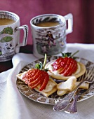 Strawberry Cream Cookie Tarts on a Plate; Cups of Coffee