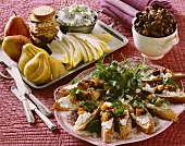 Holiday Hors d'oeuvres; Crackers with Cheese and Fruit, Roasted Nuts and Bread with Goat Cheese Spread