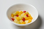 Canned fruit cocktail in a white bowl