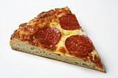 A single slice of pepperoni pizza