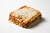 Piece of lasagna on white background
