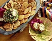 Nut and Herb Coated Cheese Ball on a Platter with Assorted Crackers; Two Crackers with Cheese