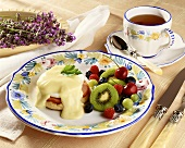 Eggs Benedict with Fruit Salad; Cup of Tea