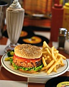 Hamburger with fries and milkshake