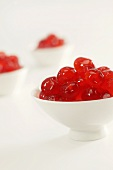 Three Bowls of Candied Red Cherries on White
