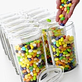 Hand filling containers with jelly beans
