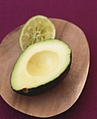 A Pitted Avocado Half and a Squeezed Lime