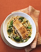 A Salmon Fillet in Broth with Noodles, Broccoli and Snow Peas