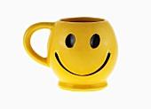 Yellow coffee mug with smiley face