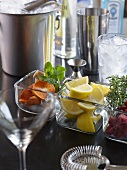 Bar Scene; Glasses, Ice, Shakers and Assorted Garnishes
