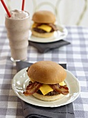 Two Bacon Cheeseburgers and a Milkshake with Two Straws in Diner