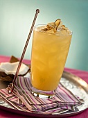 Coconut Cooler over Ice in Tall Glass with Glass Stirrer on Silver Tray