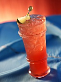 Pomegranate Margarita on the Rocks with Lime Wedge