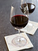 Two Glasses of Red Wine on White Cocktail Napkins