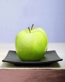 Two Granny Smith Apples on a Square Black Plate