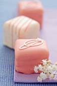 Pretty Pink and White Petits Fours with Small White Flowers
