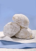 Three Snowball Cookies Stacked on a White Napkin