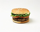 Hamburger with tomato and lettuce leaf