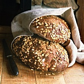 Two wholemeal loaves with rolled oats