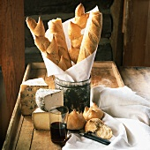 Rustic still life with cheese, bread and red wine