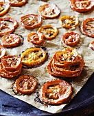 Roasted tomato slices on baking parchment