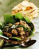 Braised beef on banana leaf (India)
